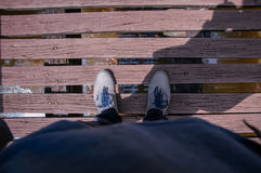 Da Feet. Just a picture of me on a wooden bridge royalty free stock photo