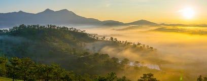 Da lat, lam dong, viet nam- feb 12, 2017: beautyful landscape of da lat city, a small vietnamese pagoda in fog and the pine hill. Beautyful landscape of da lat royalty free stock images