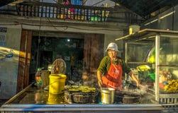 Da lat, lam dong, viet nam- feb 12, 2017: The woman making vietnamese pancake Royalty Free Stock Image