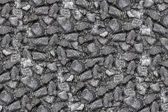 Da lona monocromática de aço desigual áspera afiada cinzenta do tom de muitas pedras projeto pequeno da geologia do fundo da pedr fotos de stock royalty free
