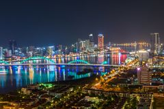 Da Nang, Vietnam – Business and Administrative District of Da Nang city on the Han River during night with night views. Picture. Da Nang, Vietnam royalty free stock photo