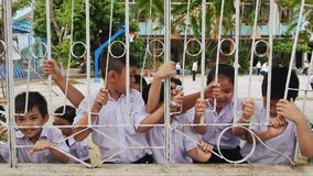 DA NANG, VIETNAM - OCTOBER 8, 2016: Schoolboys of Vietnam. Children are having fun outside the fence in the school yard. stock video footage