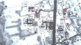 Da parte superior opinião aérea para baixo de uma cidade da Europa Oriental típica na neve Imagens de Stock