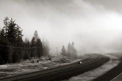 Da uno stato all'altro in nebbia Fotografia Stock