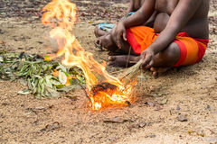 DABANA, SRI LANKA - CIRCA DECEMBER 2016: Vedda men. Making fire. Veddas are an indigenous people of Sri Lanka living in tribes in the jungle Stock Images