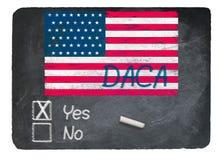 DACA концепция да используя мел на классн классном шифера стоковая фотография