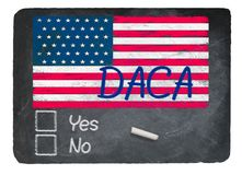 DACA concept using chalk on slate blackboard. DACA Vote message written in chalk on a chalky natural slate blackboard for current debate over Dreamers Royalty Free Stock Image