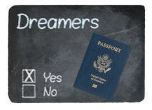 DACA Yes concept using chalk on slate blackboard. DACA Yes Vote message written in chalk on a chalky natural slate blackboard with Passport for Dreamers Royalty Free Stock Image