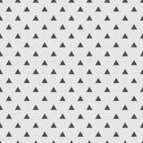 Dachówkowy wektoru wzór z czarnymi trójbokami na popielatym tle Zdjęcia Stock