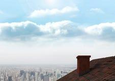 Dach z kominem i miasta niebem Obrazy Stock