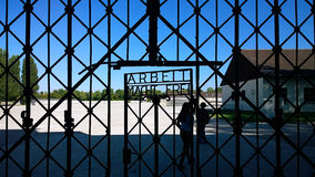 Dachau, Arbeit macht frei (work liberates). Dachau, Germany -  Entrance to the nazi concentration camp, now memorial site and museum Royalty Free Stock Photos