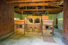 Dachau, Germany - July 30, 2015: Brick ovens inside the old crematorium building showing gruesome reality of what Stock Photos