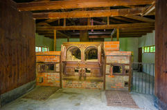 Dachau, Germany - July 30, 2015: Brick ovens inside the old crematorium building showing gruesome reality of what Royalty Free Stock Images