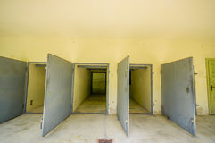 Dachau, Germany - July 30, 2015: Heavy metal doors leading into the krematorium building at concentration camp Stock Photos