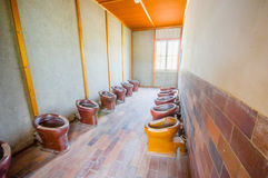 Dachau, Germany - July 30, 2015: Inside bathroom are with many toilets installed in a row for all prisoners to use at concentratio Stock Photo