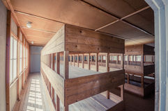 Dachau, Germany - July 30, 2015: Inside sleeping quarters with wooden bunk beds showing prisoners terrible living conditions Stock Photo