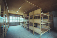 Dachau, Germany - July 30, 2015: Inside sleeping quarters with wooden bunk beds showing prisoners terrible living Royalty Free Stock Image