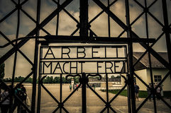 Dachau, Germany - July 30, 2015: Metal sign at entrance gate to concentration camp which reads Arbeit Macht Frei Stock Image