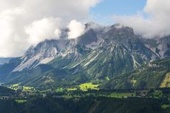 Dachstein Mountains over Schladming, Northern Limestone Alps, Austria. Dachstein Mountains over Schladming town, Northern Limestone Alps, Austria stock photo