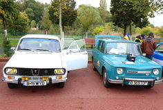 Dacia 1300 and 1100. Front view in parking outdoor at vintage cars parade in Bucharest, Romania. Dacia 1100 was the first model of car manufactured by stock photos