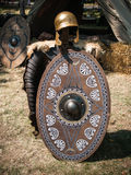 Dacian Armour. Dacian leather armour with metal helmet and wooden shield, presented at the Tomis Dacian Festival 2013 stock images