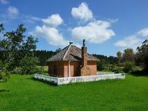 Dacre Cottage histórico en la reserva de Okura Imagenes de archivo