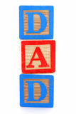 DAD. Childs wooden blocks with letters spelling DAD royalty free stock images