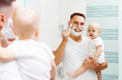 Dad And Baby Son Shave Royalty Free Stock Photography