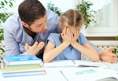 Dad is angry. Dad is angry because his daughter don`t want to do her homework stock photography