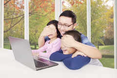 Dad avoid his children watching movie on laptop Stock Photo