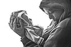 Dad and baby. Dad and his little baby son in hoodies Stock Photos