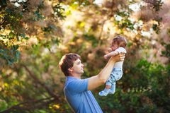 Dad with a baby boy in his arms, close-up, summer Stock Photography