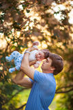 Dad with a baby boy in his arms, close-up, summer Stock Images