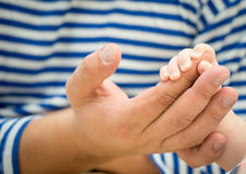 Dad and baby holding hands Stock Images