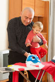 Dad with baby  ironing Stock Photos