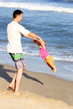Dad with baby on the  sea Royalty Free Stock Photo