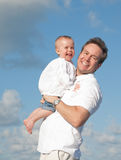 Dad and Baby Smiling in the Sun Stock Image