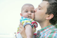 Dad and baby son outdoors Stock Images
