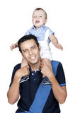 Dad carrying his son on shoulder. Son on his father's shoulders having fun Stock Photography