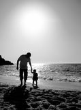Dad and child on the beach at at sunset Royalty Free Stock Images