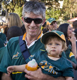 Dad and child in crowd for farewell to Boks Stock Photos