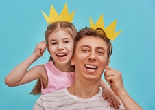 Dad and child are holding paper crown Stock Photos