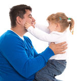 Dad and child playing and pinching cheeks isolated on white back Stock Photography