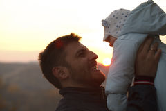 Dad and Child silhouette at sunset Royalty Free Stock Photo