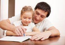 Dad with child writing. Father helping daughter doing homework. Parent with child writing Royalty Free Stock Photos