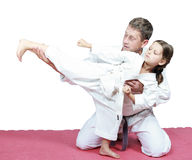 Dad coached daughter punch kicking karate. Sport family dad coached daughter punch kicking karate Royalty Free Stock Photos