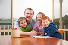 Dad coloring kids pictures with children. Dad coloring kids art pictures with children Royalty Free Stock Photo