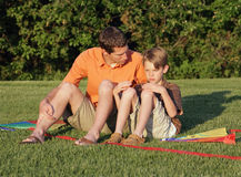 Dad comfort. Unhappy son at the park being comforted by father Royalty Free Stock Images