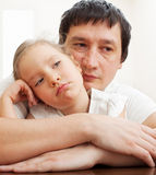 Dad comforts a sad girl Stock Images