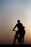 Dad cycling with son. A man carrying a child on his bike Stock Photo